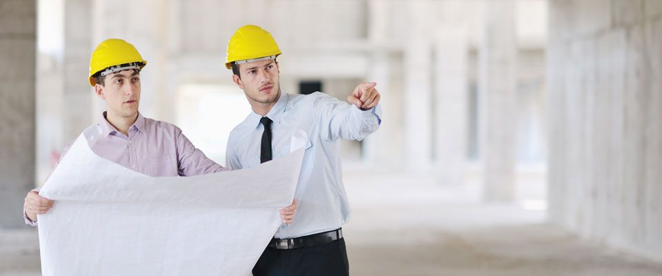 two contractors with building plans